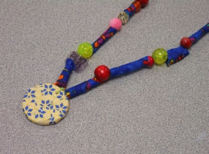 A student's decoupaged pendant necklace (accented by fabric beads she rolled herself, too!) We share a love of all things rainbow.