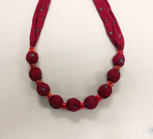 Vintage style fabric necklace made using marbles inside a fabric tube with pony beads in between