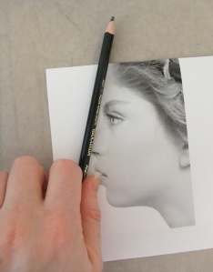 Have you ever seen artists when drawing a still life or model lifting their pencil up, squinting at it, and then laying it against their paper? They are using their pencil as a guide to gauge the correct angle, and we can do that with a photo reference as well.  Lay your pencil against the angle of the forehead to gauge the angle start, and then move the pencil over to your paper and create that same angle.