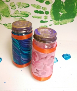 Salt and Pepper Shakers by Amber : Empty glass spice jars with holes punched in the lids. The tops are painted with enamel and the jars are wrapped with fabric and ribbon accent, sealed, again, with mod podge.